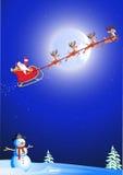 Santa dans son traîneau de cerfs communs Image libre de droits
