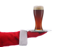 Santa with Dark Beer Glass on Tray Royalty Free Stock Photos