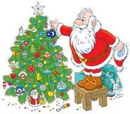 Santa Decorates A Christmas Tree Royalty Free Stock Photos
