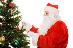 Santa Decorating Christmas Tree Stock Image