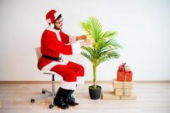 Santa decorating a tree Royalty Free Stock Photos