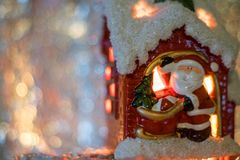 Santa Clause in the house. Santa decoration for Christmas with lovely  candle light Royalty Free Stock Image