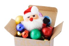 Santa and decorative baubles in gift box Royalty Free Stock Photography