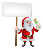 Santa Decorator Sign. A Christmas cartoon illustration of Santa Claus holding sign and paintbrush Royalty Free Stock Image