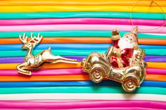 Santa and deer on balloons, rainbow, colorful background Stock Photos
