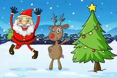 Santa and a deer beside the christmas tree Royalty Free Stock Photo