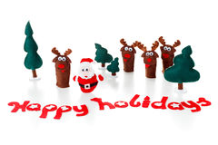 Santa, deer dolls on a shiny surface for christmas, xmas, white. Royalty Free Stock Photo