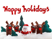 Santa, deer dolls in snow for christmas, xmas on white. Royalty Free Stock Photo