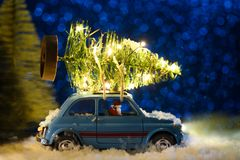 Santa delivering Christmas or New Year tree stock images