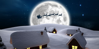 Santa delivery presents to village Royalty Free Stock Photography