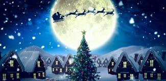 Santa delivery presents to village Stock Image