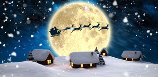 Santa delivery presents to village Royalty Free Stock Images