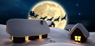 Santa delivery presents to village Stock Photography