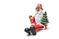 Santa di seduta con i piedini attraversati Immagini Stock