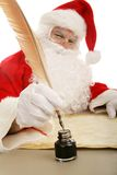 Santa Dips His Quill Stock Photo