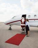 Santa Disembarking Private Jet While ProefAnd stock foto's