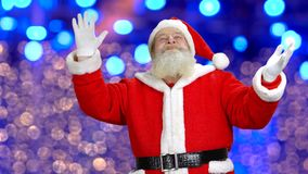Santa is doing some magic. Christmas is coming. Blue lights behind the santa stock video footage