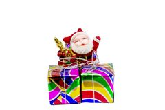 Santa doll and gift box isolate on white background stock photography