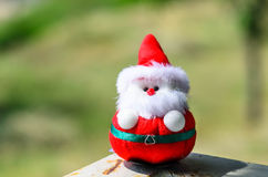 Santa doll in the park outdoor with sunlight. Stock Photo