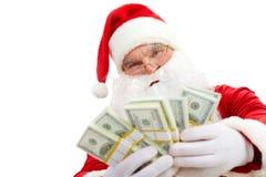 Santa with dollars. Photo of happy Santa Claus with dollar bills looking at camera Stock Images