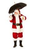 Santa: Dotyczący O deszczu na bożych narodzeniach Obrazy Royalty Free