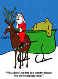 Santa is Downsizing Reindeer Workers. Christmas cartoon showing Santa riding the red nose reindeer and saying, 'You don't seem too crazy about the downsizing Stock Photo