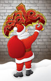 Santa draws sale. On the brick wall at night Royalty Free Stock Photography