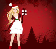 Santa dressed girl with present. Stock Photography