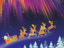 Santa drives sledge with reindeers Royalty Free Stock Photo
