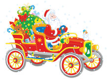 Santa driving a car with gifts Stock Photo