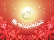 Santa driving his sleigh on a moonlit night Royalty Free Stock Image