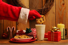 Santa Dunking Cookie Royalty Free Stock Images