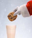 Santa Dunking Cookie Snowy Background Fotos de archivo libres de regalías