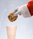 Santa Dunking Cookie Snowy Background Royalty Free Stock Photos