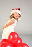 Santa dziewczyny kapelusz się uśmiecha Zdjęcia Royalty Free