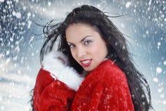 Santa e bufera di neve sexy fotografie stock