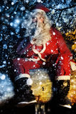 Santa e neve immagine stock