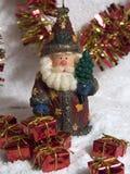 Santa e presente Immagine Stock
