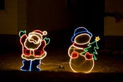 Santa e pupazzo di neve Immagini Stock Libere da Diritti