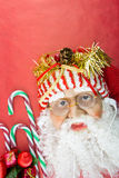 Santa with earphones, on red with ornaments Stock Image