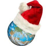 Santa earth. Computer generated earth wearing a santa hat royalty free stock photography