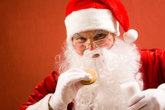 Santa eating Royalty Free Stock Photos