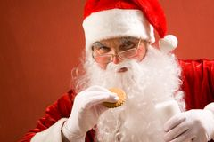 Santa eating Stock Photography