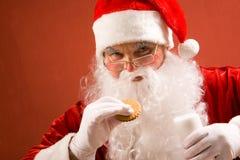 Santa eating Stock Photography