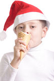 Santa eats ice-cream Stock Images