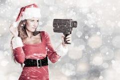 Santa effectuent une présentation images stock