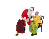 Santa and an Elderly Woman royalty free stock photography