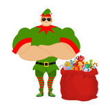 Santa Elf And Red Bag. Claus Bodyguards. Christmas Guards. Protecting Gifts For New Year. Defenders Of Gifts For Children. Royalty Free Stock Images