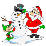 Santa & Elf Build A Snowman Royalty Free Stock Photo