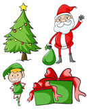 Santa and elf by the christmas tree Stock Photo